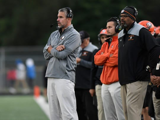 Birmingham Brother Rice head coach Adam Korzeniewski, left, watches his team as they played against Detroit Catholic Central in the first quarter, Saturday, Sept. 22, 2018 at Hurley Field in Berkley, Mich.  Catholic Central defeated Brother Rice, 21-0.  (Jose Juarez/Hometown Life)