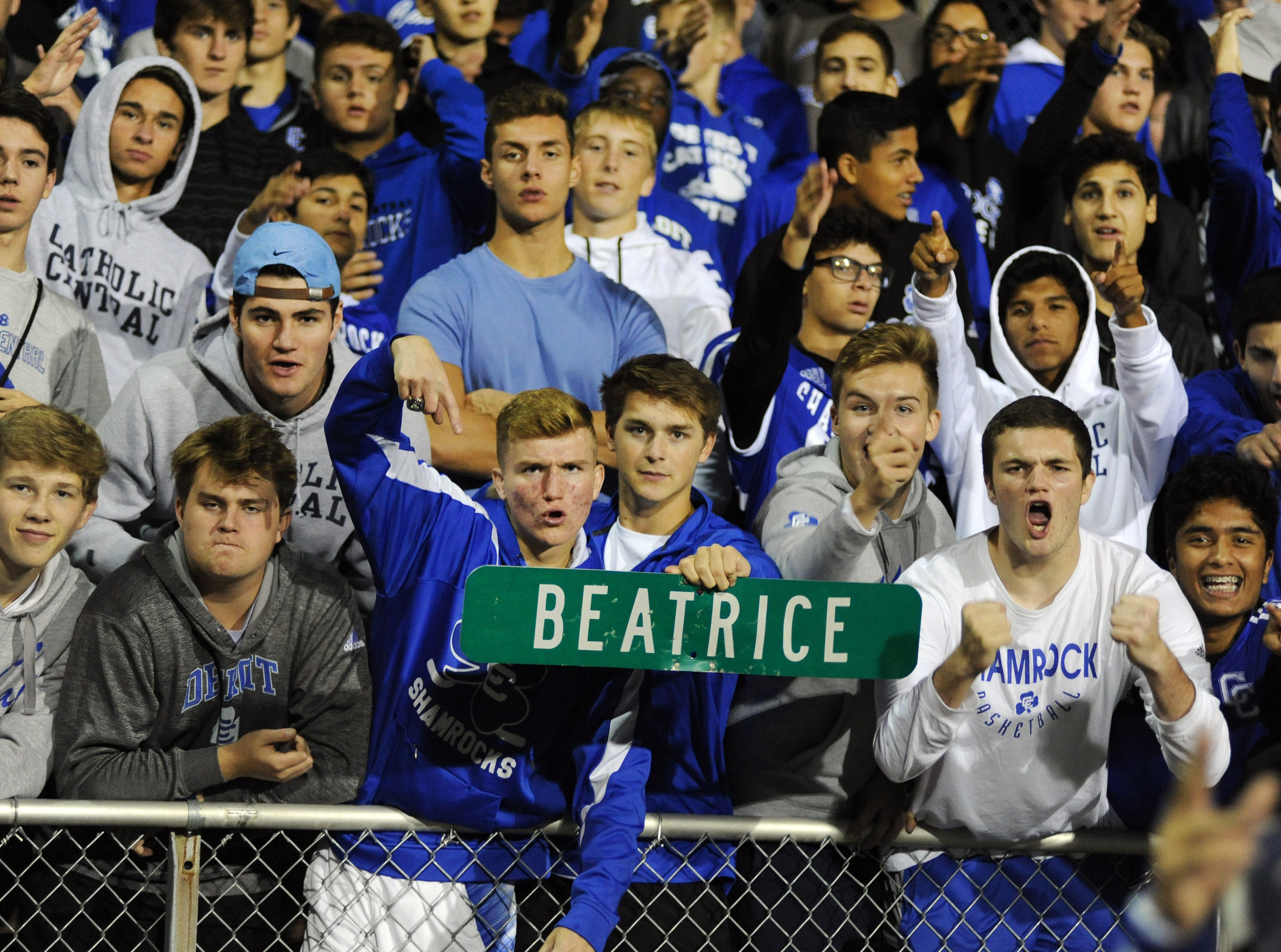 """Detroit Catholic Central students show off a Beatrice street sign as their team played against Birmingham Brother Rice in the third quarter, Saturday, Sept. 22, 2018 at Hurley Field in Berkley, Mich.  Catholic Central defeated Brother Rice, 21-0.  Catholic Central previously played their home games in Redford on a field along Beatrice Street, and Beatrice also spells out as """"BEAT RICE""""; to the delight of the student fanbase."""