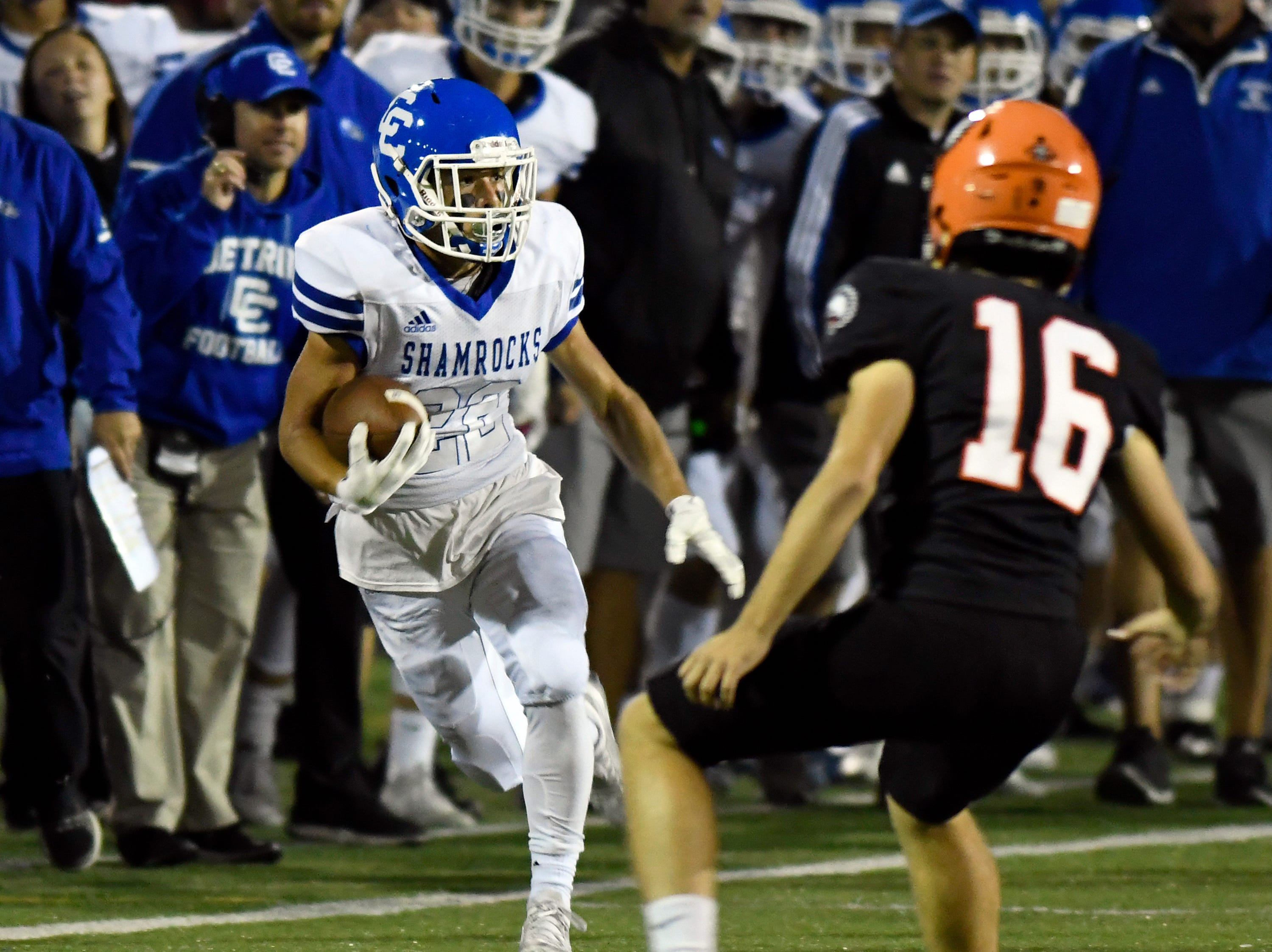 Detroit Catholic Central running back Cody Daraban (22), left, rushes for yardage as he is chased by Birmingham Brother Rice player Ray Margherio (16) in the fourth quarter, Saturday, Sept. 22, 2018 at Hurley Field in Berkley, Mich.  Catholic Central defeated Brother Rice, 21-0.