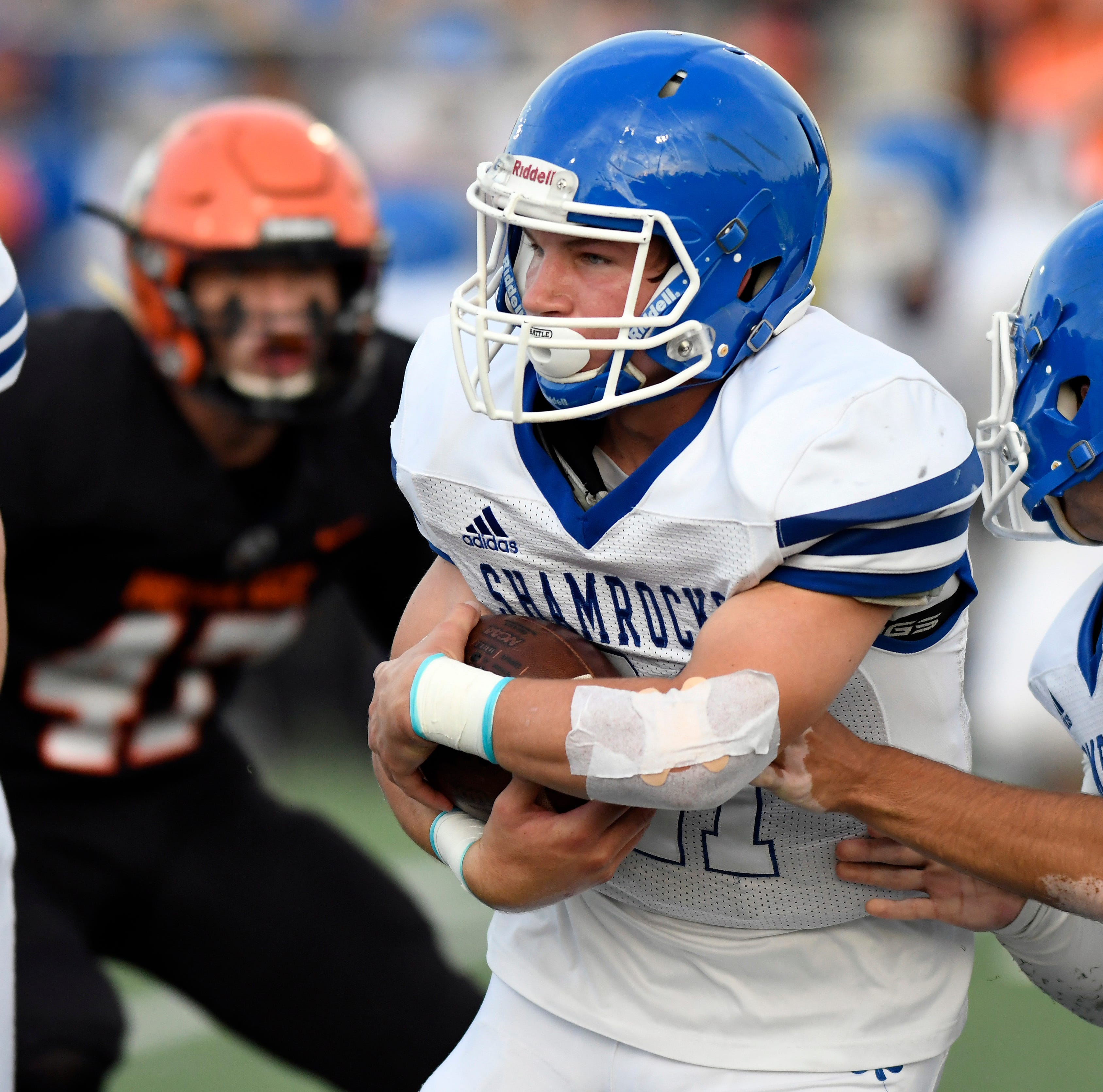 Detroit Catholic Central running back Keegan Koehler (21) rushes for yardage against Birmingham Brother Rice in the first quarter of Saturday's game.
