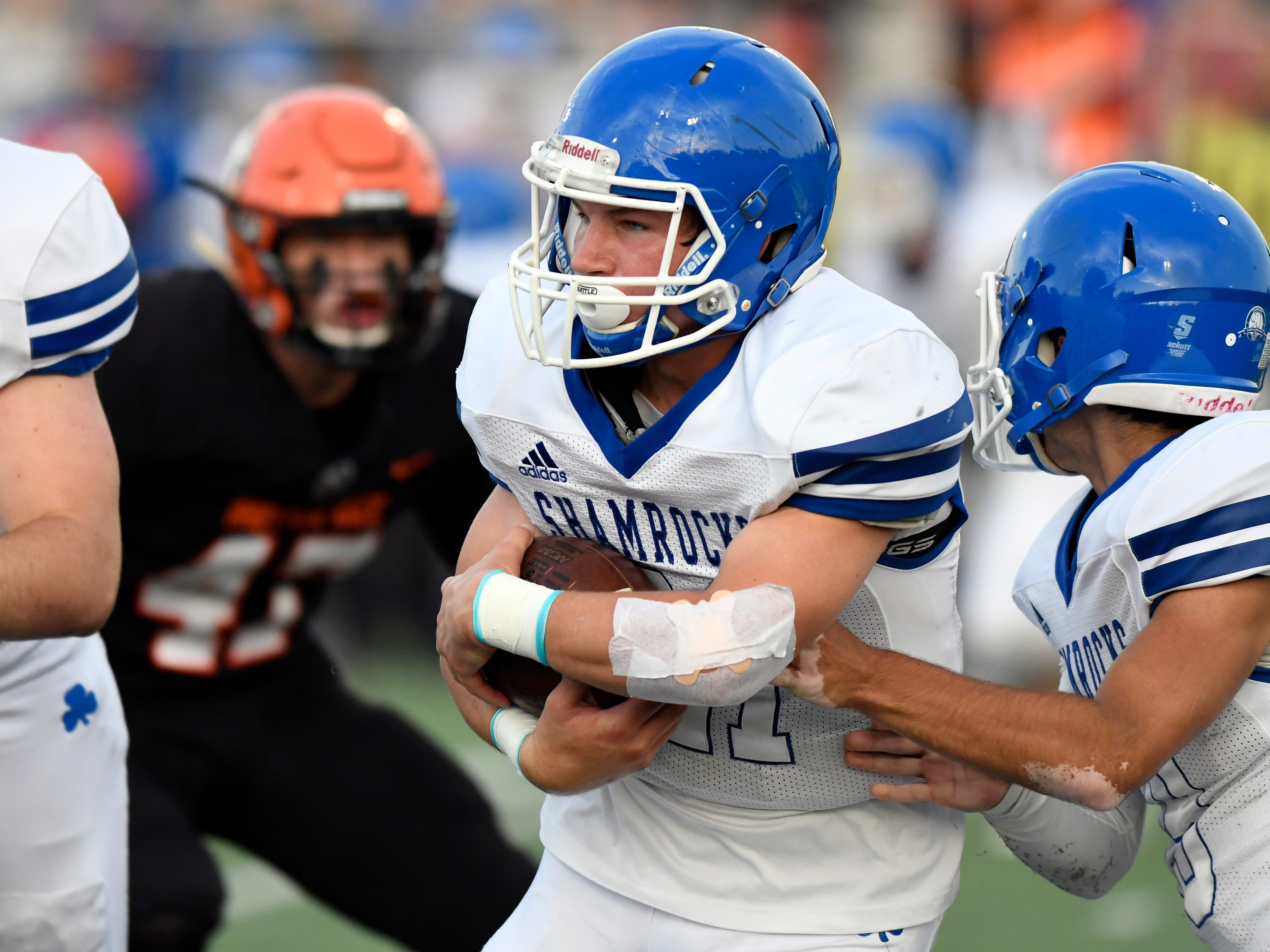 Detroit Catholic Central running back Keegan Koehler (21) takes the handoff from quarterback Jack Beno (19) and runs for yardage against Birmingham Brother Rice in the first quarter, Saturday, Sept. 22, 2018 at Hurley Field in Berkley, Mich.  Catholic Central defeated Brother Rice, 21-0.  (Jose Juarez/Hometown Life)