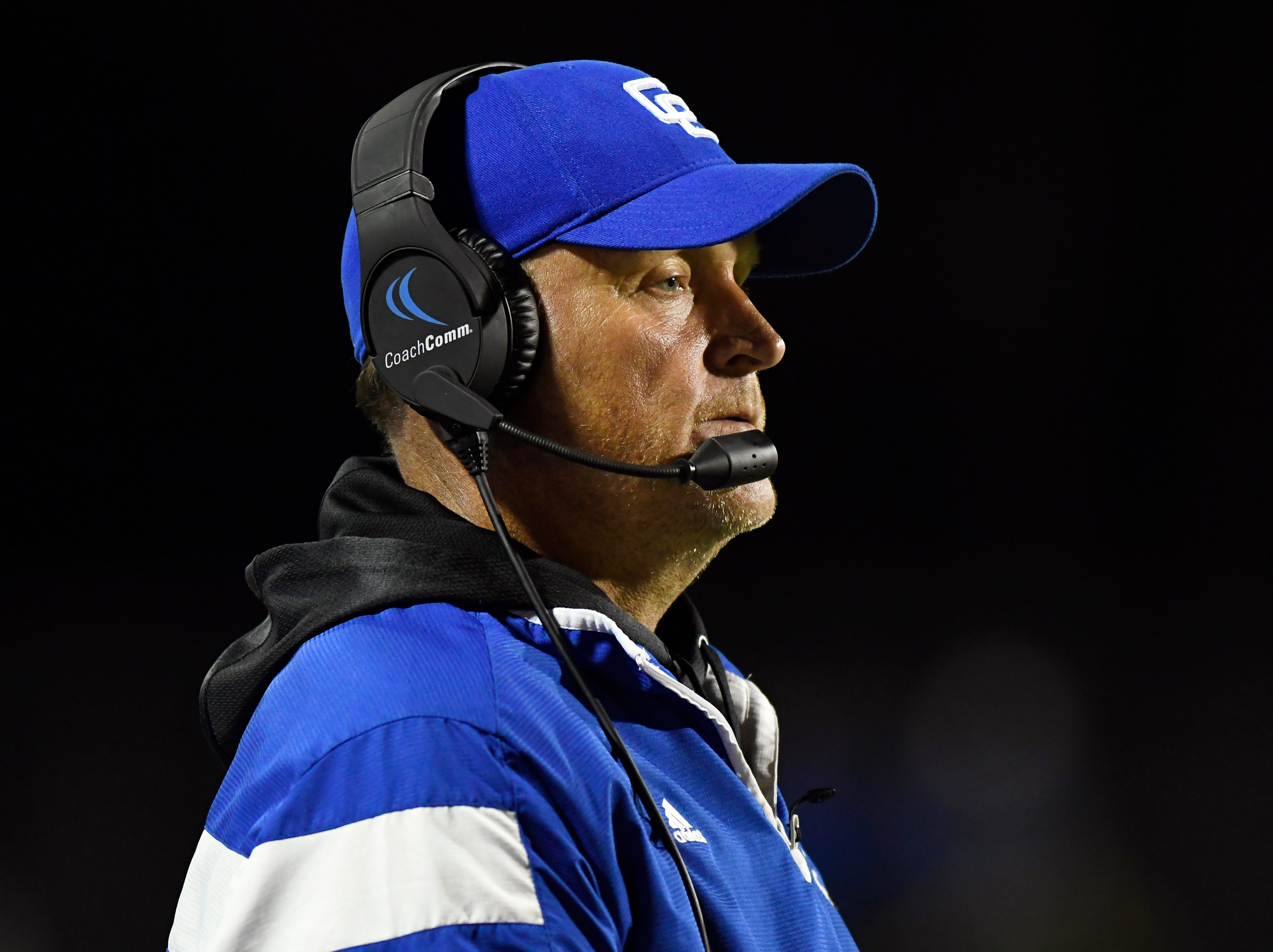 Detroit Catholic Central football head coach Dan Anderson watches his team play against Birmingham Brother Rice in the third quarter, Saturday, Sept. 22, 2018 at Hurley Field in Berkley, Mich.  Catholic Central defeated Brother Rice, 21-0.