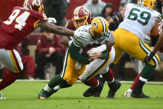 Green Bay Packers quarterback Aaron Rodgers is sacked by Washington's Jonathan Allen in the first quarter of Sunday's game at FedEx Field in Landover, Maryland.