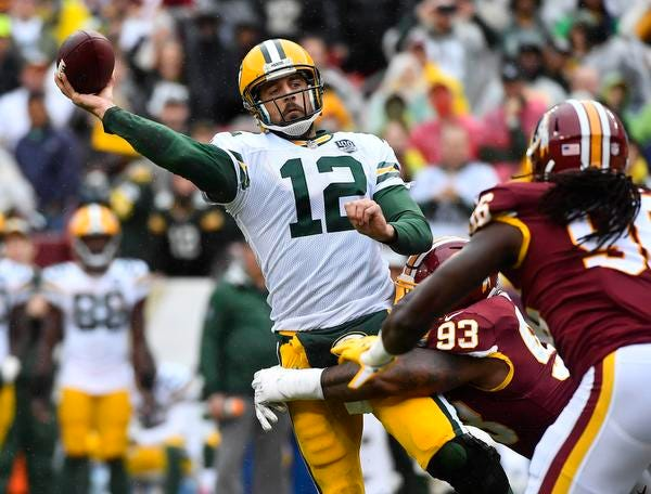 Sep 23, 2018; Landover, MD, USA; Green Bay Packers quarterback Aaron Rodgers (12) is pressured by Washington Redskins defensive end Jonathan Allen (93) during the first half at FedEx Field. Mandatory Credit: Brad Mills-USA TODAY Sports