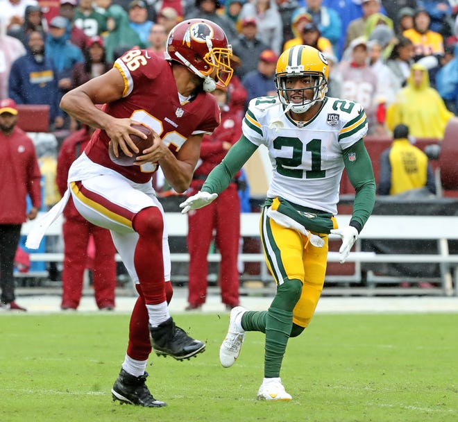Green Bay Packers defensive back Ha Ha Clinton-Dix (21) gives up a catch over the middle to tight end Jordan Reed (86) against Washington Sunday, September 23, 2018 at FedEx Field in Landover, MD.