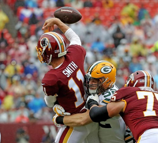 Green Bay Packers linebacker Clay Matthews (52) hits quarterback Alex Smith (11) against Washington Sunday, September 23, 2018 at FedEx Field in Landover, MD. Jim Matthews/USA TODAY NETWORK-Wisconsin