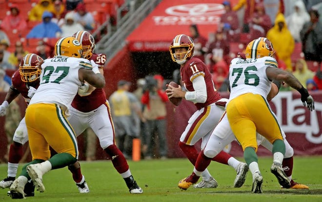 Green Bay Packers nose tackle Kenny Clark (97) and defensive tackle Mike Daniels (76) try to rush quarterback Alex Smith (11) against Washington Sunday, September 23, 2018 at FedEx Field in Landover, MD.