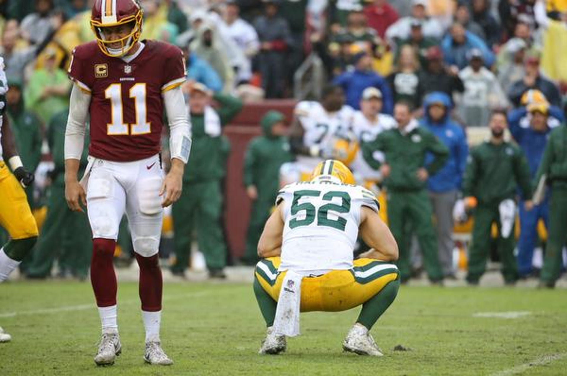Sep 23, 2018; Landover, MD, USA; Green Bay Packers linebacker Clay Matthews (52) reacts after sacking Washington Redskins quarterback Alex Smith (11) in the third quarter at FedEx Field. Matthews received a roughing the passer penalty on the play. The Redskins won 31-17. Mandatory Credit: Geoff Burke-USA TODAY Sports