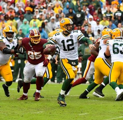 Sep 23, 2018; Landover, MD, USA; Green Bay Packers quarterback Aaron Rodgers (12) prepares to throw against the Washington Redskins during the first half at FedEx Field. Mandatory Credit: Brad Mills-USA TODAY Sports