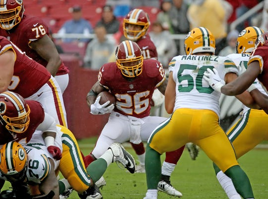 Green Bay Packers linebacker Blake Martinez (50) tries to fill a hole on running back Adrian Peterson (26) against Washington Sunday, September 23, 2018 at FedEx Field in Landover, MD.