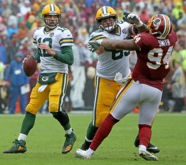 Green Bay Packers quarterback Aaron Rodgers (12) looks downfield as offensive tackle David Bakhtiari (69) blocks against Washington Sunday, September 23, 2018 at FedEx Field in Landover, MD. Jim Matthews/USA TODAY NETWORK-Wisconsin