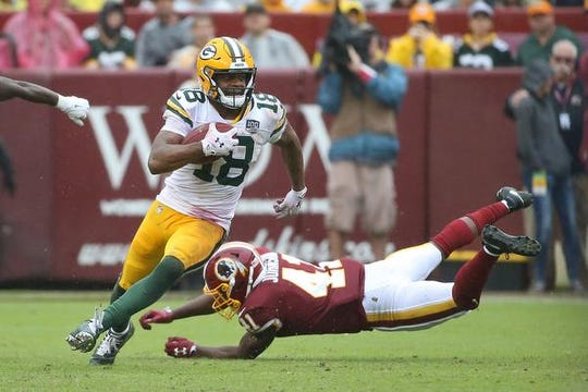 Sep 23, 2018; Landover, MD, USA; Green Bay Packers wide receiver Randall Cobb (18) runs with the ball past Washington Redskins defensive back Danny Johnson (41) in the third quarter at FedEx Field. The Redskins won 31-17. Mandatory Credit: Geoff Burke-USA TODAY Sports