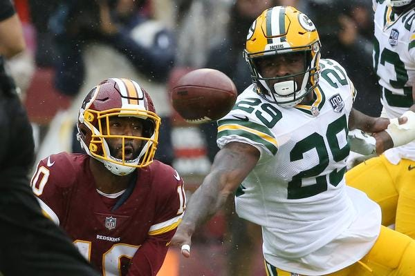 Sep 23, 2018; Landover, MD, USA; Washington Redskins wide receiver Paul Richardson (10) catches a touchdown pass as Green Bay Packers defensive back Kentrell Brice (29) defends in the first quarter at FedEx Field. Mandatory Credit: Geoff Burke-USA TODAY Sports
