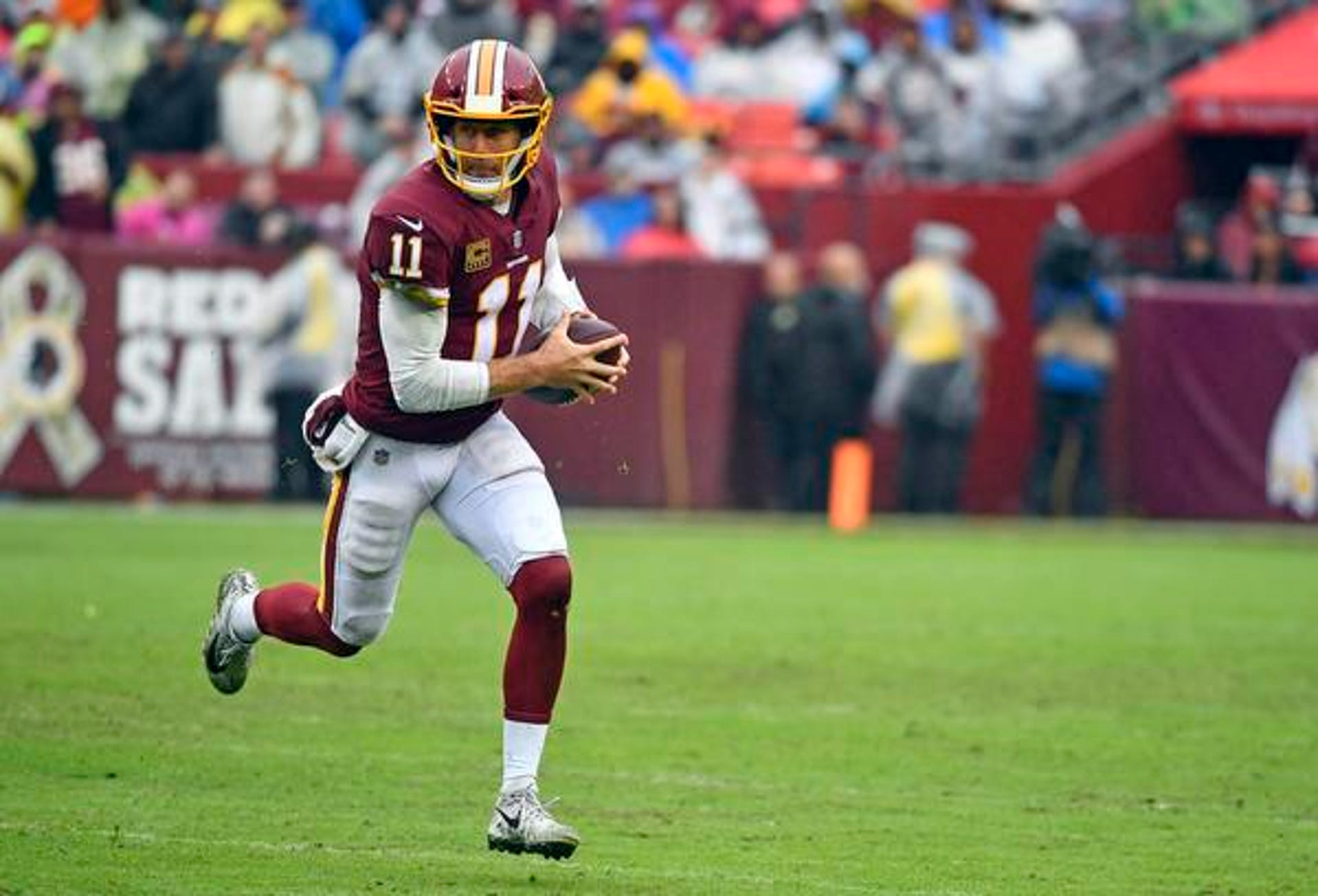 Sep 23, 2018; Landover, MD, USA; Washington Redskins quarterback Alex Smith (11) scrambles against the Green Bay Packers during the second half at FedEx Field. Mandatory Credit: Brad Mills-USA TODAY Sports