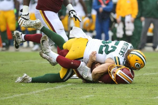 Sep 23, 2018; Landover, MD, USA; Green Bay Packers linebacker Clay Matthews (52) sacks Washington Redskins quarterback Alex Smith (11) in the third quarter at FedEx Field. Matthews received a roughing the passer penalty on the play. The Redskins won 31-17. Mandatory Credit: Geoff Burke-USA TODAY Sports