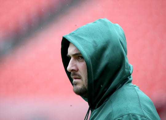 Green Bay Packers center Corey Linsley (63) doesn't seem to be a fan of the rain before the game against Washington Sunday, September 23, 2018 at FedEx Field in Landover, MD.