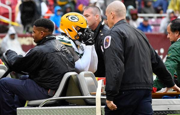 Sep 23, 2018; Landover, MD, USA; Green Bay Packers defensive end Muhammad Wilkerson (96) reacts after suffering an apparent leg injury against the Washington Redskins during the first half at FedEx Field. Mandatory Credit: Brad Mills-USA TODAY Sports