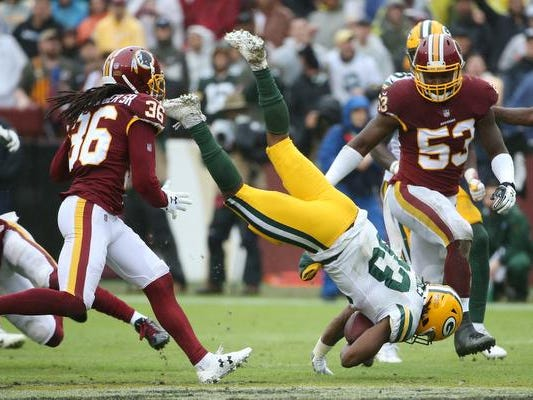 Sep 23, 2018; Landover, MD, USA; Green Bay Packers running back Aaron Jones (33) is tackled by Washington Redskins linebacker Mason Foster (54) in the third quarter at FedEx Field. The Redskins won 31-17. Mandatory Credit: Geoff Burke-USA TODAY Sports