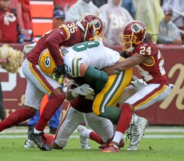 Green Bay Packers tight end Jimmy Graham (80) gets gang tackled after making a first down reception against Washington Sunday, September 23, 2018 at FedEx Field in Landover, MD. Jim Matthews/USA TODAY NETWORK-Wisconsin