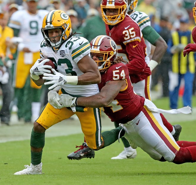 Green Bay Packers running back Aaron Jones (33) runs the ball against Washington Sunday, September 23, 2018 at FedEx Field in Landover, MD.