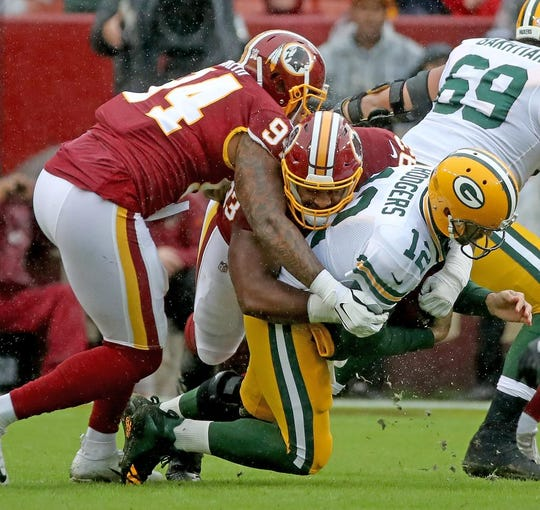 Green Bay Packers quarterback Aaron Rodgers (12) gets sacked against Washington Sunday, September 23, 2018 at FedEx Field in Landover, MD. Jim Matthews/USA TODAY NETWORK-Wisconsin