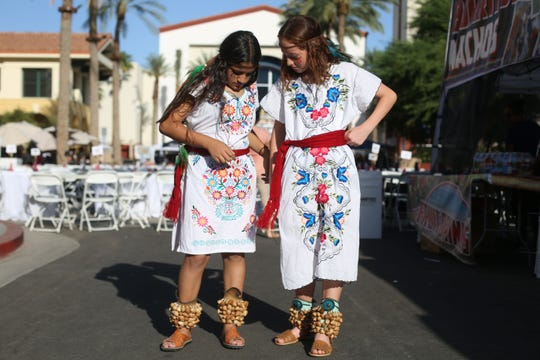 Quetzalli Garcia and Allison Torres, both 11, in costume to perform Aztec dance during the Tejano Music Fest on Saturday, September 22, 2018 in Cathedral City.