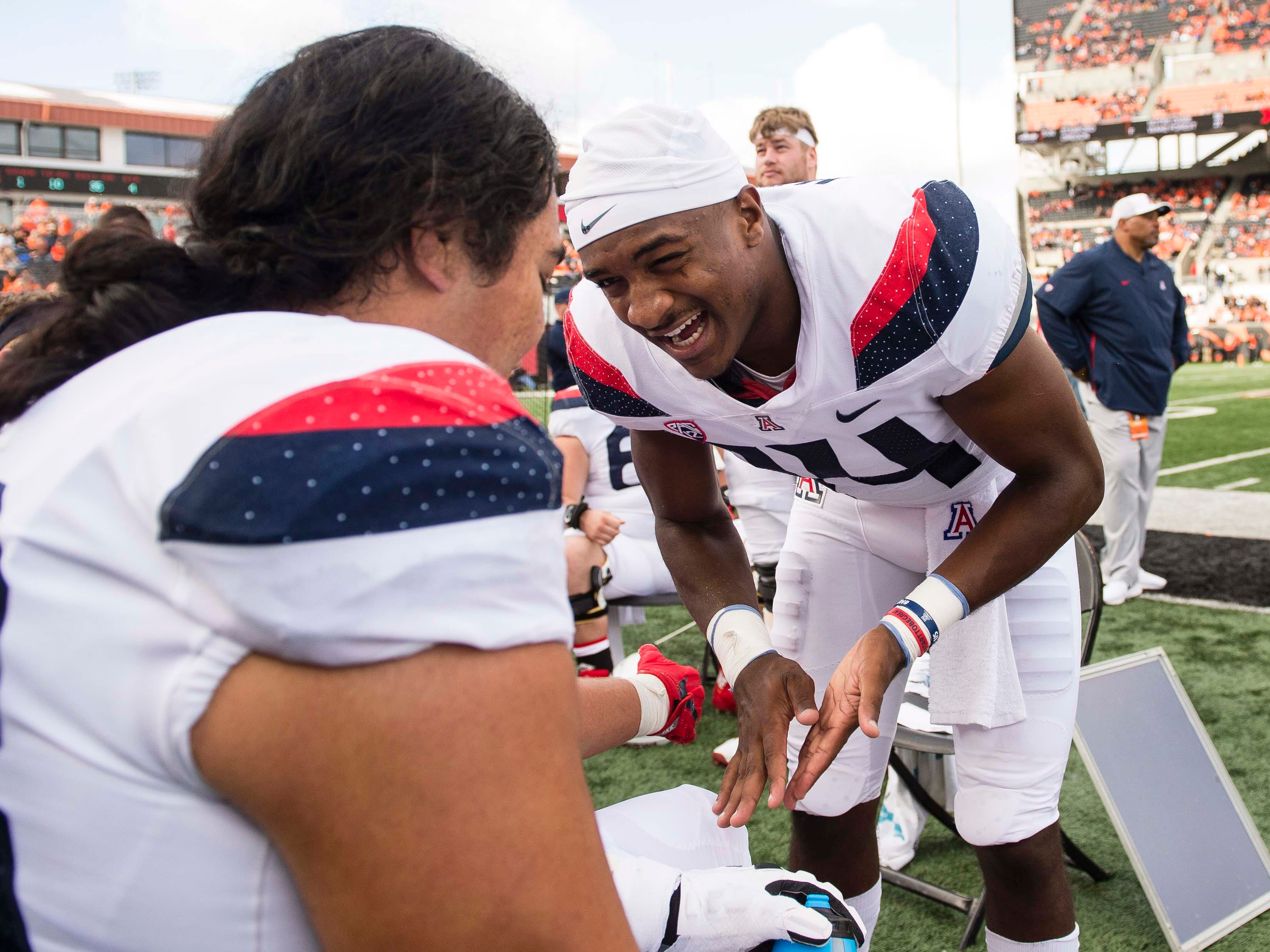 Sep 22, 2018; Corvallis, OR, USA; Arizona Wildcats quarterback Khalil Tate (14) talks with his teammates on the sidelines during the second half against the Oregon State Beavers at Reser Stadium. The Arizona Wildcats won 35-14.
