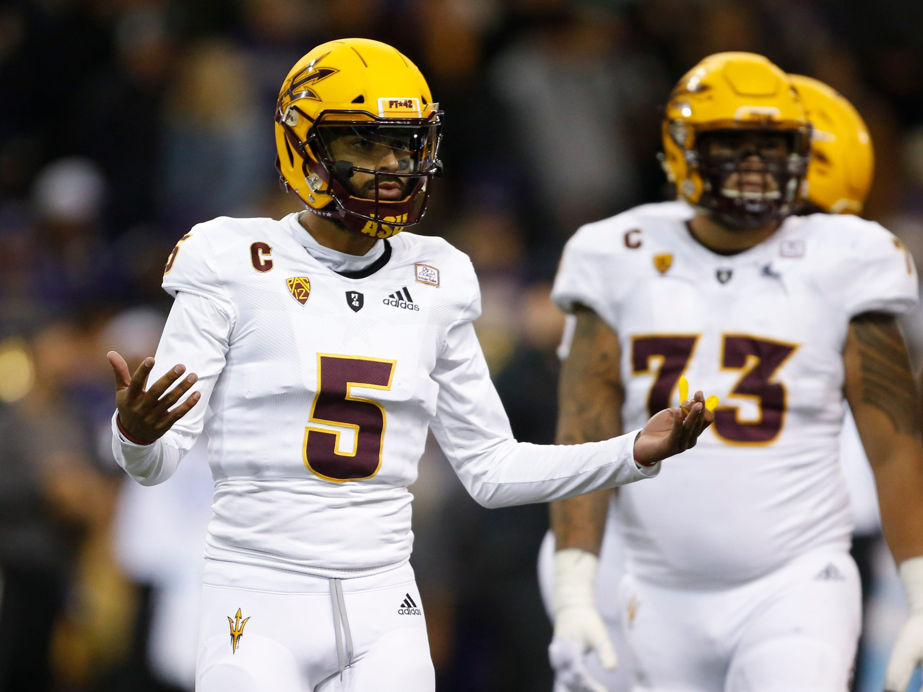 Sep 22, 2018; Seattle, WA, USA; Arizona State Sun Devils quarterback Manny Wilkins (5) gestures toward the sidelines during the second quarter against the Washington Huskies at Husky Stadium.