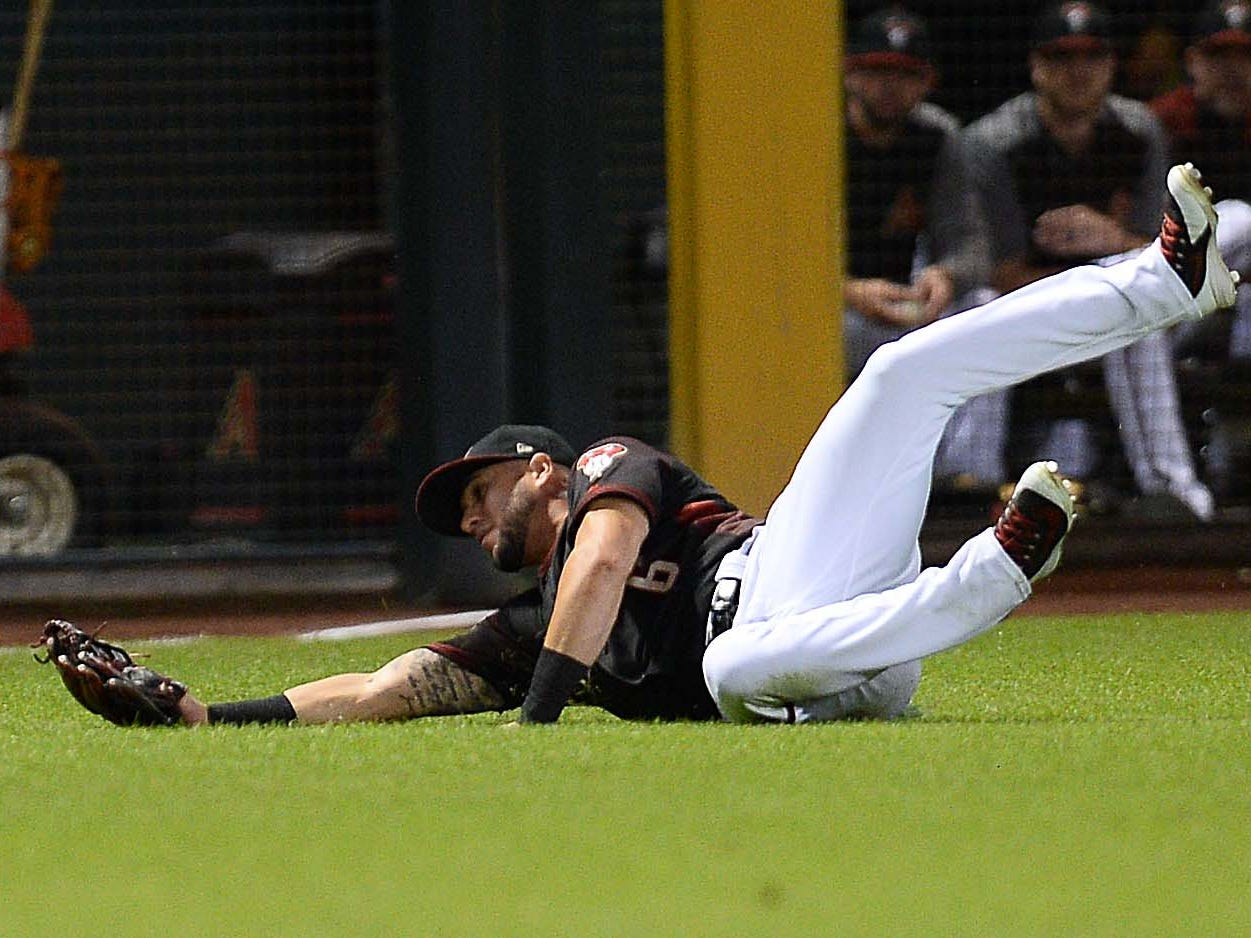 Sep 22, 2018; Phoenix, AZ, USA; Arizona Diamondbacks right fielder David Peralta (6) makes a diving catch against the Colorado Rockies during the ninth inning at Chase Field.