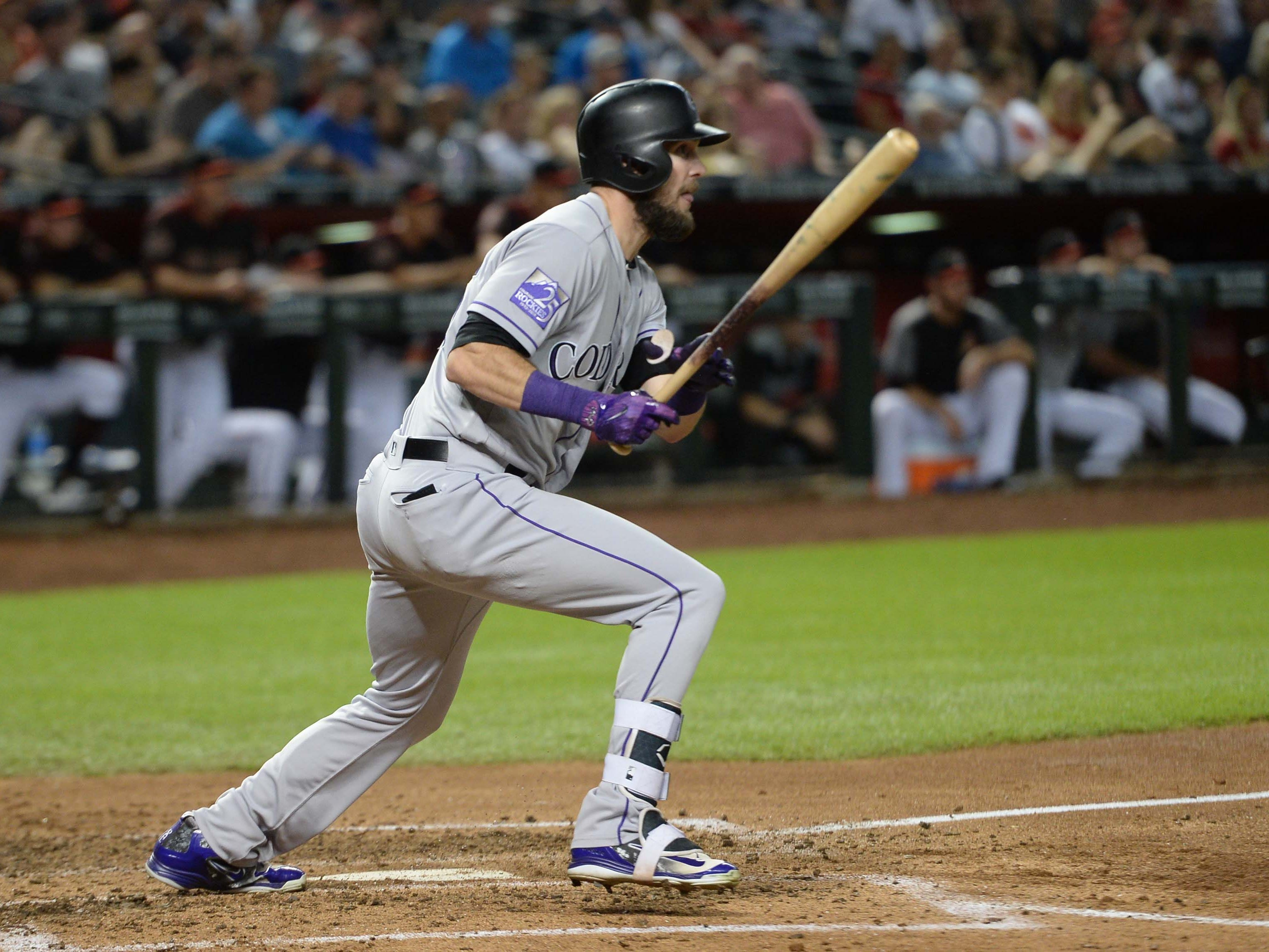 Sep 22, 2018; Phoenix, AZ, USA; Colorado Rockies left fielder David Dahl (26) hits an RBI single against the Arizona Diamondbacks during the third inning at Chase Field.