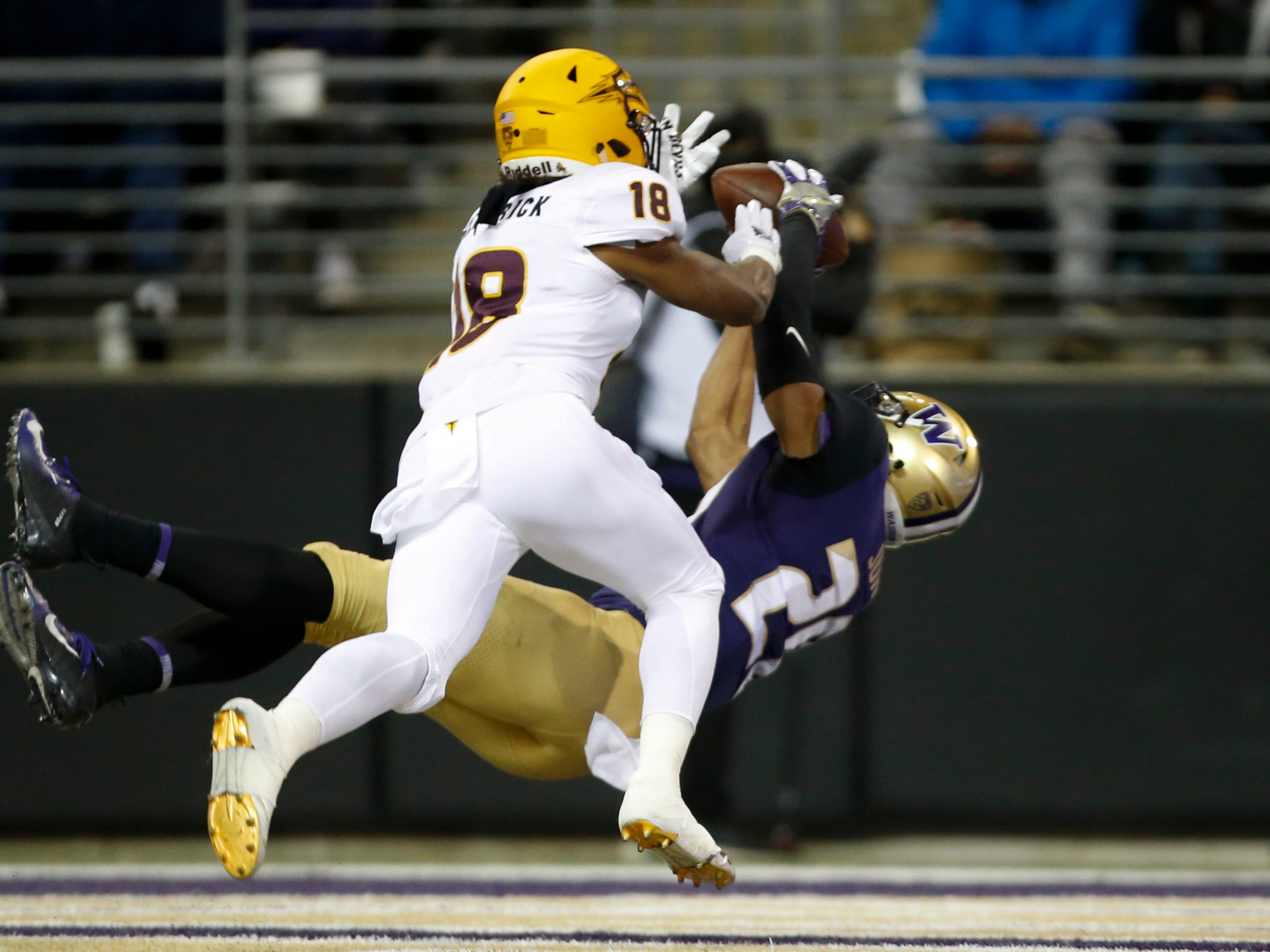 Sep 22, 2018; Seattle, WA, USA; Washington Huskies wide receiver Ty Jones (20) catches a touchdown pass over Arizona State Sun Devils cornerback Langston Frederick (18) during the first quarter at Husky Stadium.