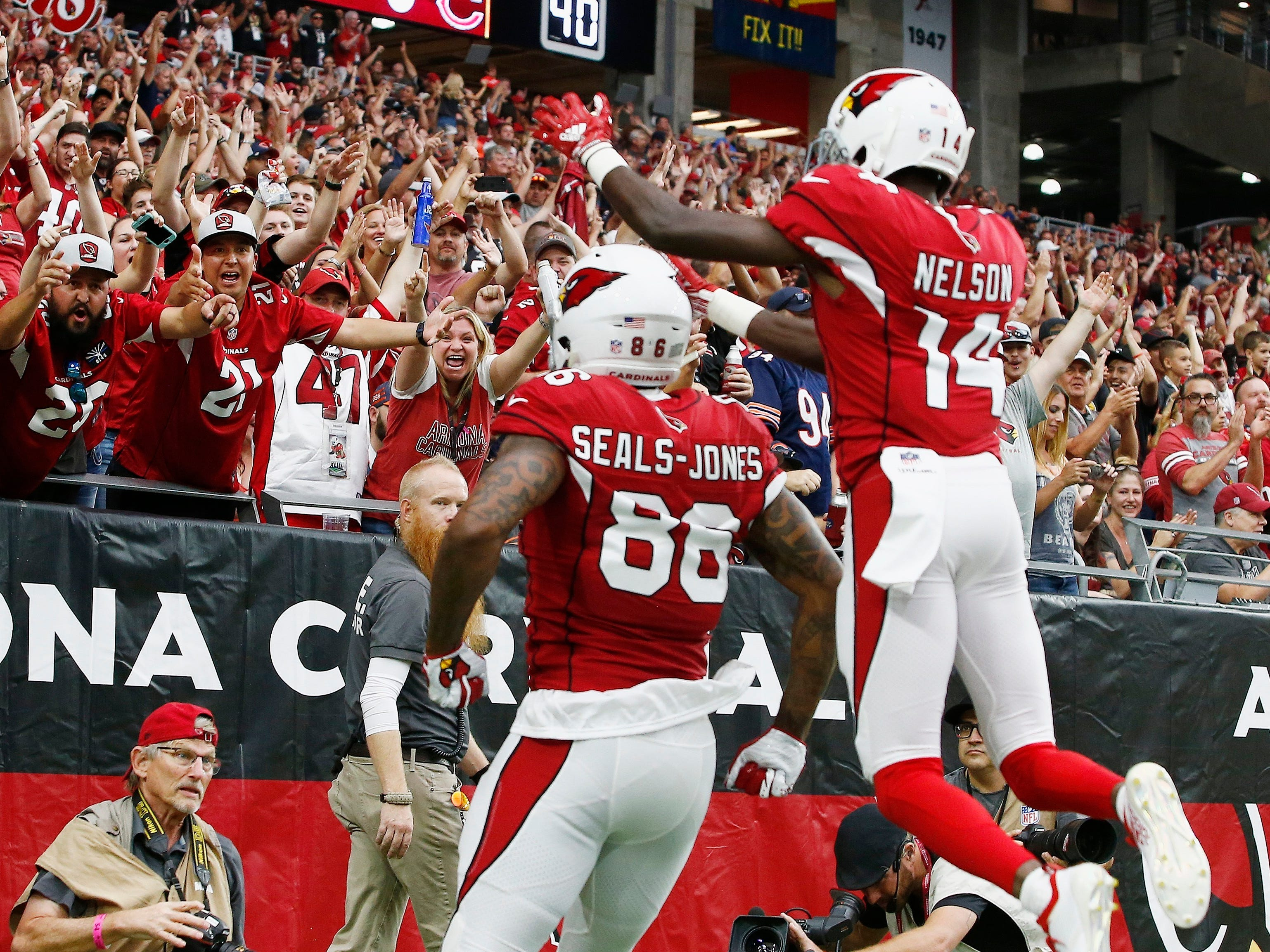 Arizona Cardinals tight end Ricky Seals-Jones (86) celebrates his touchdown against the Chicago Bears with J.J. Nelson (14) and fans during the first half of an NFL football game, Sunday, Sept. 23, 2018, in Glendale, Ariz. (AP Photo/Ralph Freso)