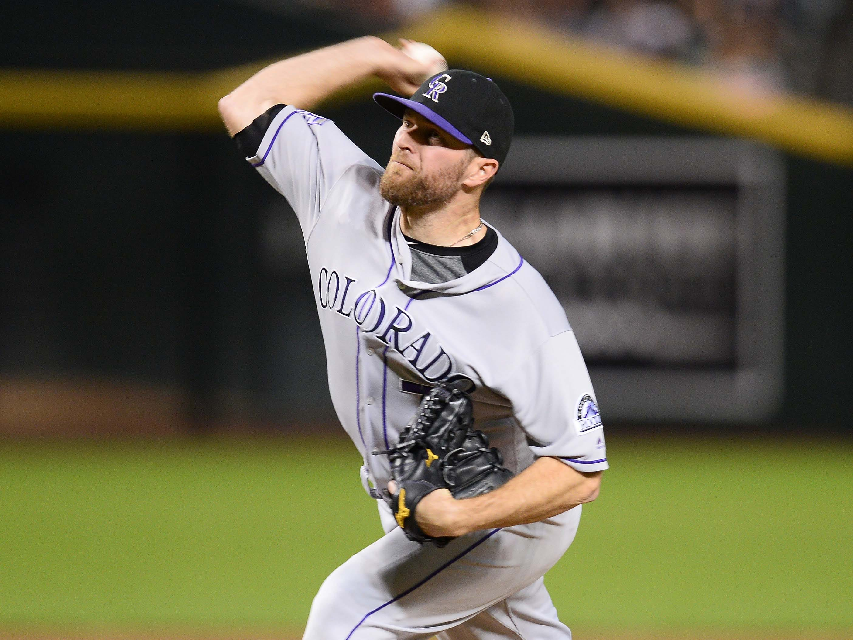 Sep 22, 2018; Phoenix, AZ, USA; Colorado Rockies relief pitcher Wade Davis (71) pitches against the Arizona Diamondbacks during the ninth inning at Chase Field.