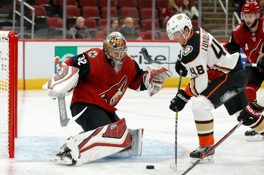 Arizona Coyotes goaltender Antti Raanta (32) makes a save on a shot by Anaheim Ducks center Isac Lundestrom (48) as Coyotes defenseman Jason Demers, right, watches during the first period of an NHL preseason hockey game Saturday, Sept. 22, 2018, in Glendale, Ariz.