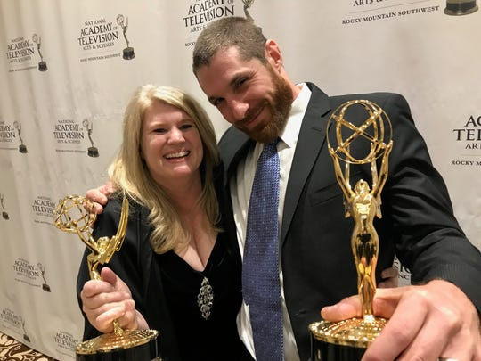 Arizona Republic photographers Cheryl Evans and David Wallace pose with their Rocky Mountain Emmy Awards during the annual gala on Sept. 23, 2018.