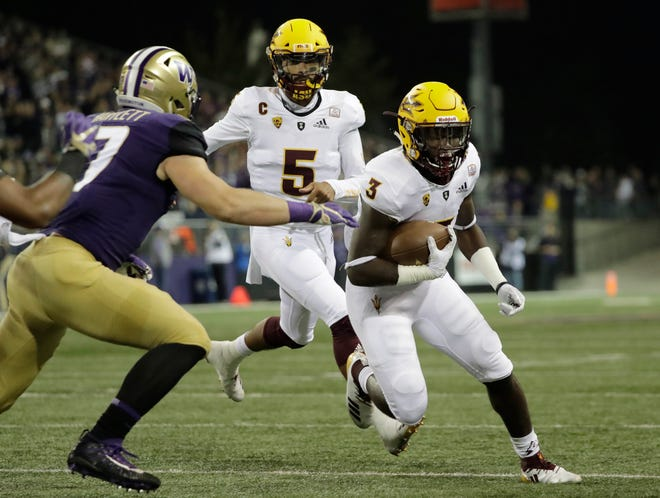 Arizona State running back Eno Benjamin (3) runs the ball after a handoff from quarterback Manny Wilkins (5) during the first half of an NCAA college football game against Washington, Saturday, Sept. 22, 2018, in Seattle.