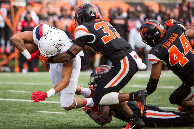 Sep 22, 2018; Corvallis, OR, USA; Arizona Wildcats wide receiver Shawn Poindexter (19) breaks away from Oregon State Beavers safety Jalen Moore (33) to score a touchdown during the second half at Reser Stadium. The Arizona Wildcats won 35-14.
