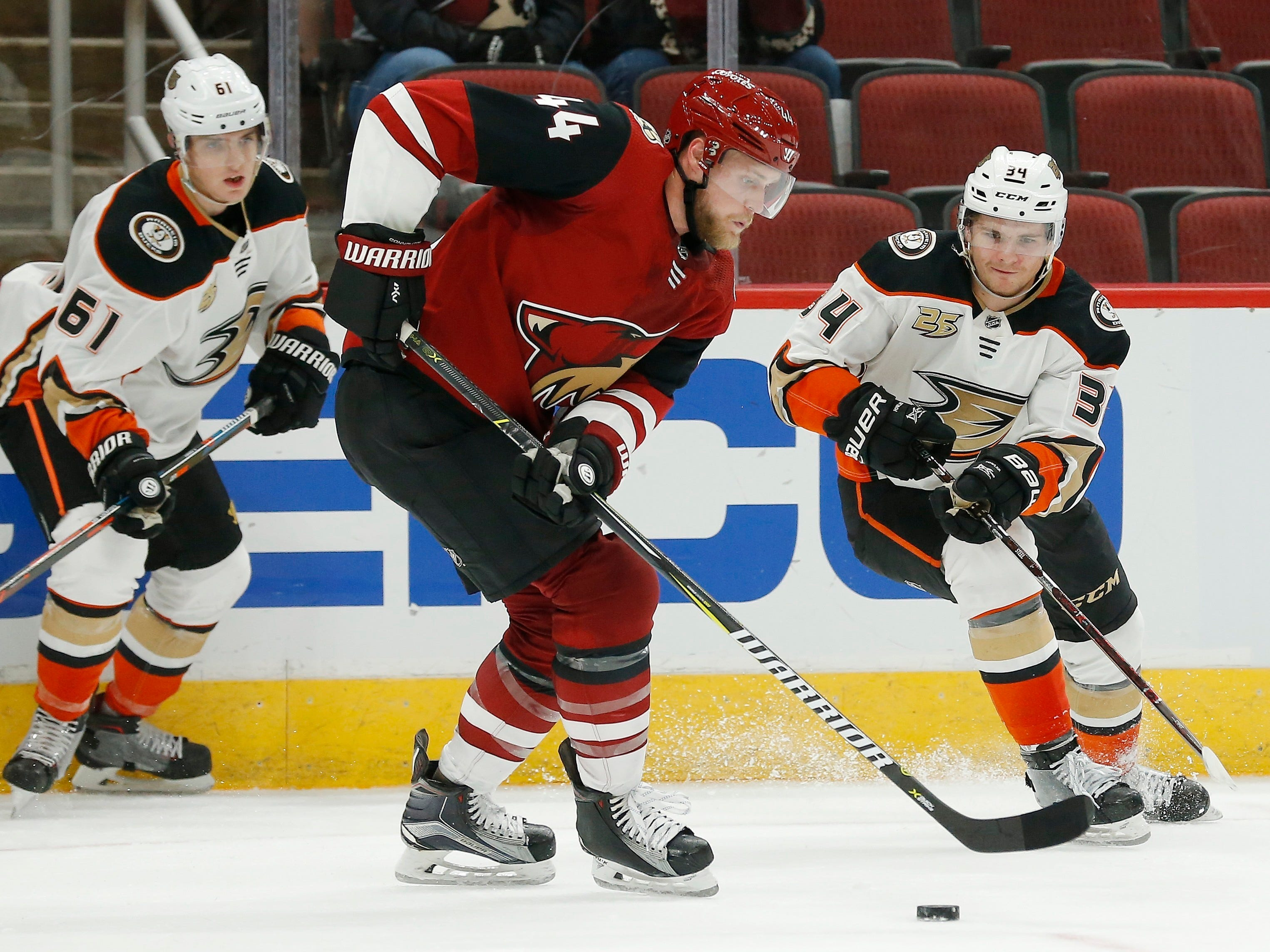 Arizona Coyotes defenseman Kevin Connauton (44) skates past Anaheim Ducks center Sam Steel (34) and right wing Troy Terry (61) during the third period of an NHL preseason hockey game Saturday, Sept. 22, 2018, in Glendale, Ariz. The Coyotes defeated the Ducks 6-1.