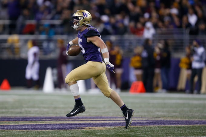 Sep 22, 2018; Seattle, WA, USA; Washington Huskies linebacker Ben Burr-Kirven (25) celebrates a fumble recovery against the Arizona State Sun Devils during the third quarter at Husky Stadium.