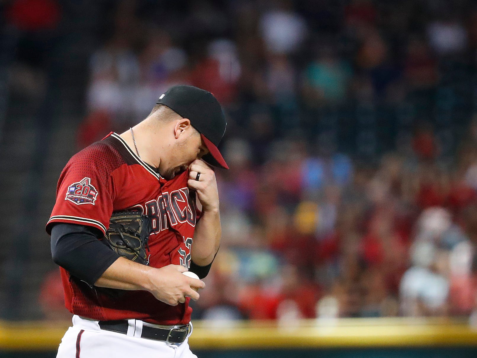 Diamondbacks Zack Godley (52) reacts after allowing a run in the fifth inning against the Rockies at Chase Field on Sept. 23, 2018.
