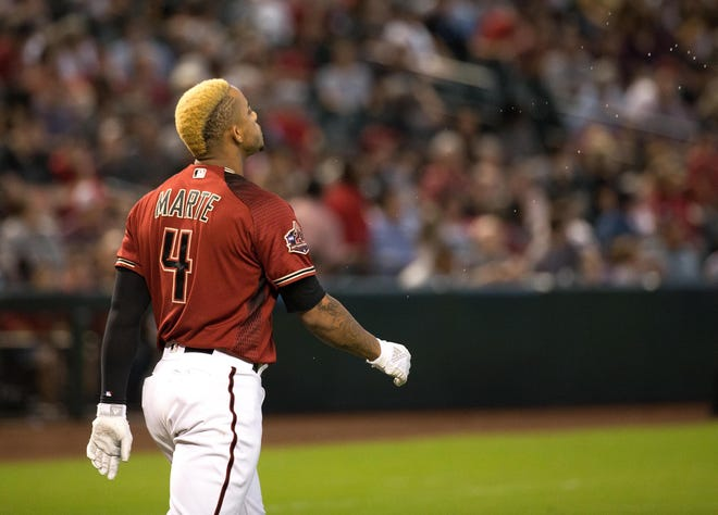 Sep 23, 2018; Phoenix, AZ, USA; Arizona Diamondbacks second baseman Ketel Marte (4) reacts after striking out to end the third inning against the Colorado Rockies at Chase Field. Mandatory Credit: Allan Henry-USA TODAY Sports