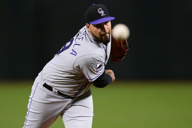 Sep 22, 2018; Phoenix, AZ, USA; Colorado Rockies starting pitcher Antonio Senzatela (49) pitches against the Arizona Diamondbacks during the first inning at Chase Field.