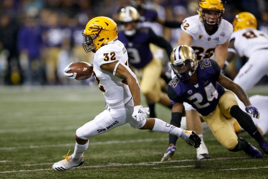 Sep 22, 2018; Seattle, WA, USA; Arizona State Sun Devils returner Paul Lucas (32) returns the ball against the Washington Huskies during the first quarter at Husky Stadium.