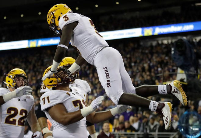 Arizona State running back Eno Benjamin (3) is tossed in the air by offensive lineman Steven Miller (71) after Benjamin scored a touchdown during the first half of an NCAA college football game against Washington, Saturday, Sept. 22, 2018, in Seattle.