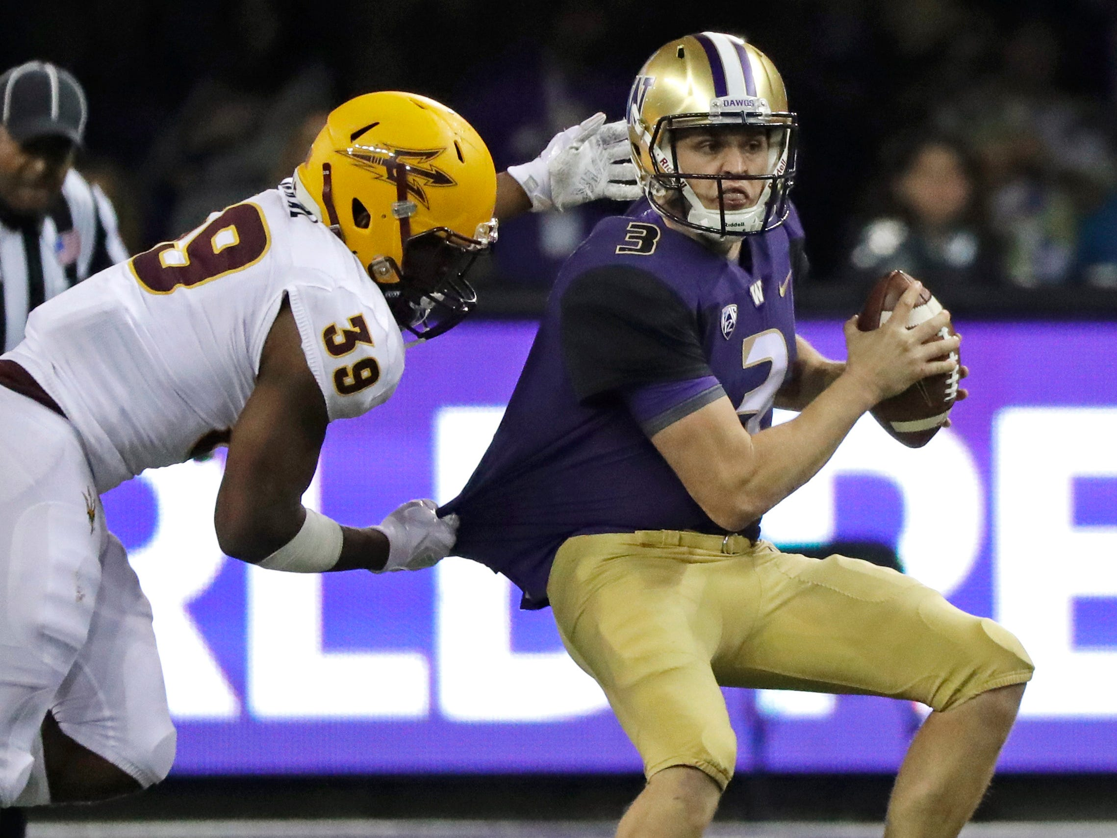 Washington quarterback Jake Browning, right, is sacked by Arizona State linebacker Malik Lawal (39) during the first half of an NCAA college football game Saturday, Sept. 22, 2018, in Seattle.