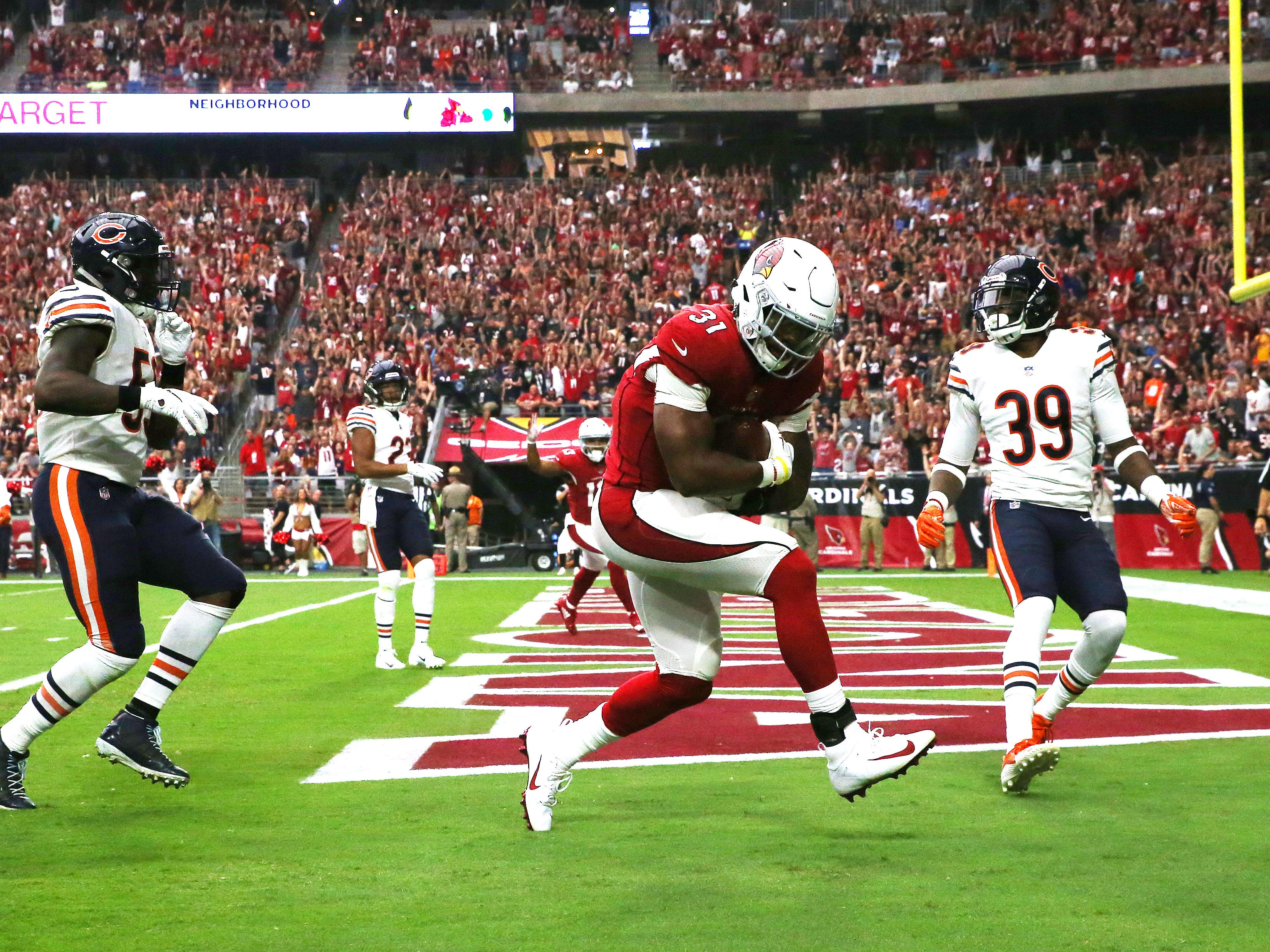 Arizona Cardinals David Johnson scores a touchdown against the Chicago Bears in the first half at State Farm Stadium in Glendale, Ariz.