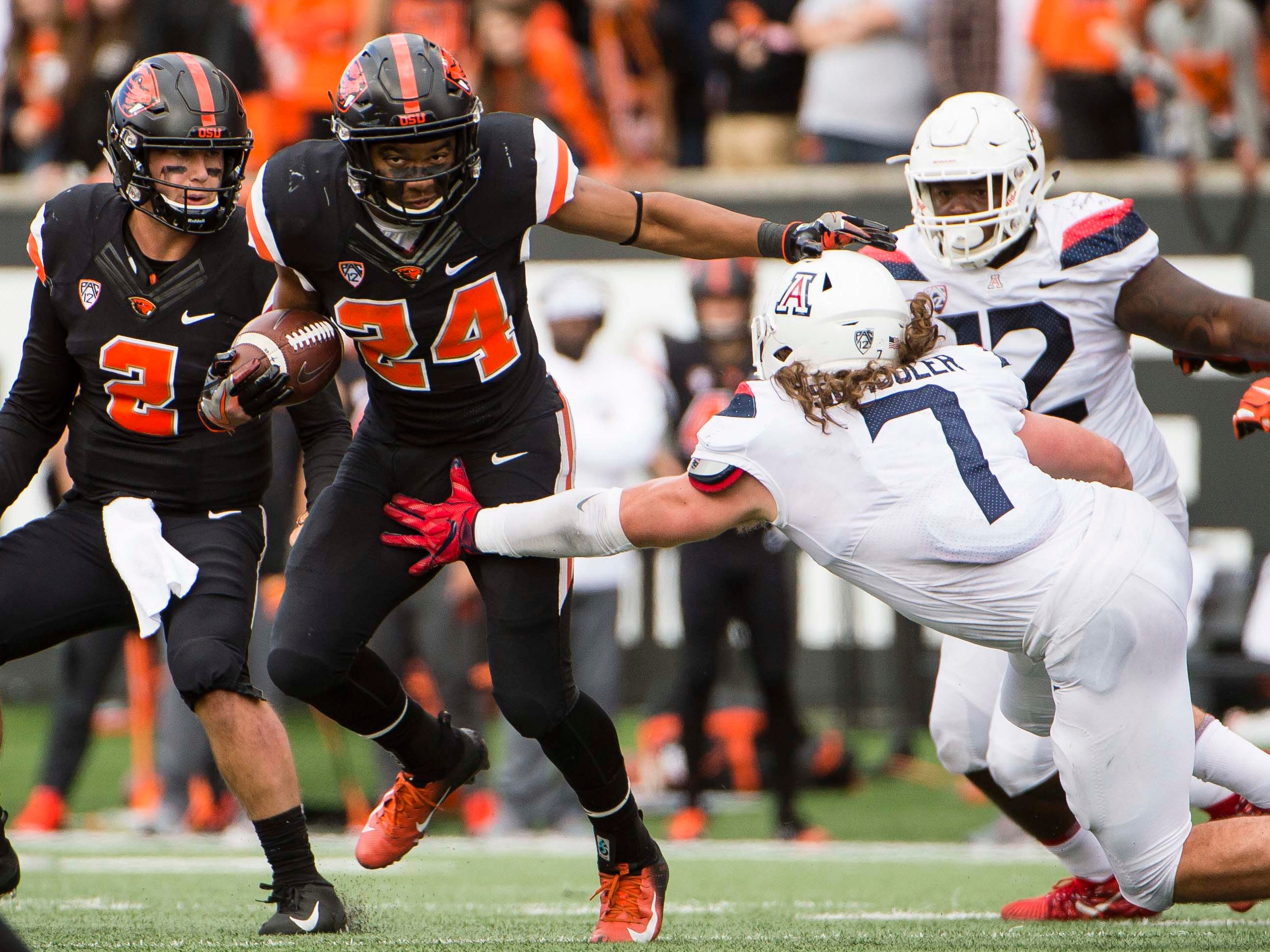 Sep 22, 2018; Corvallis, OR, USA; Oregon State Beavers running back Kase Rogers (24) breaks away from Arizona Wildcats linebacker Colin Schooler (7) during the second half at Reser Stadium. The Arizona Wildcats won 35-14.