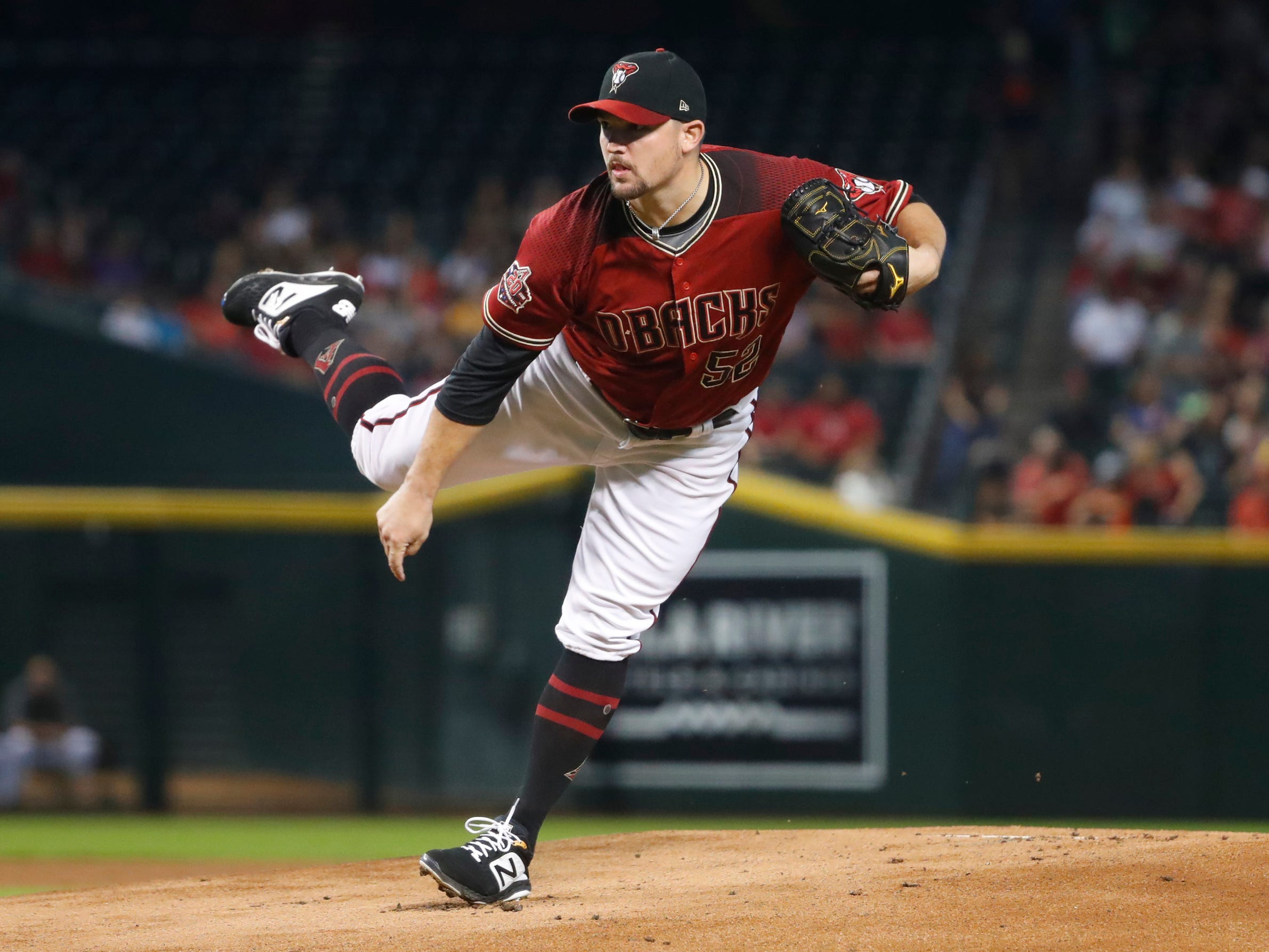 Diamondbacks Zack Godley (52) pitches against the Rockies during the first inning at Chase Field on Sept. 23, 2018.