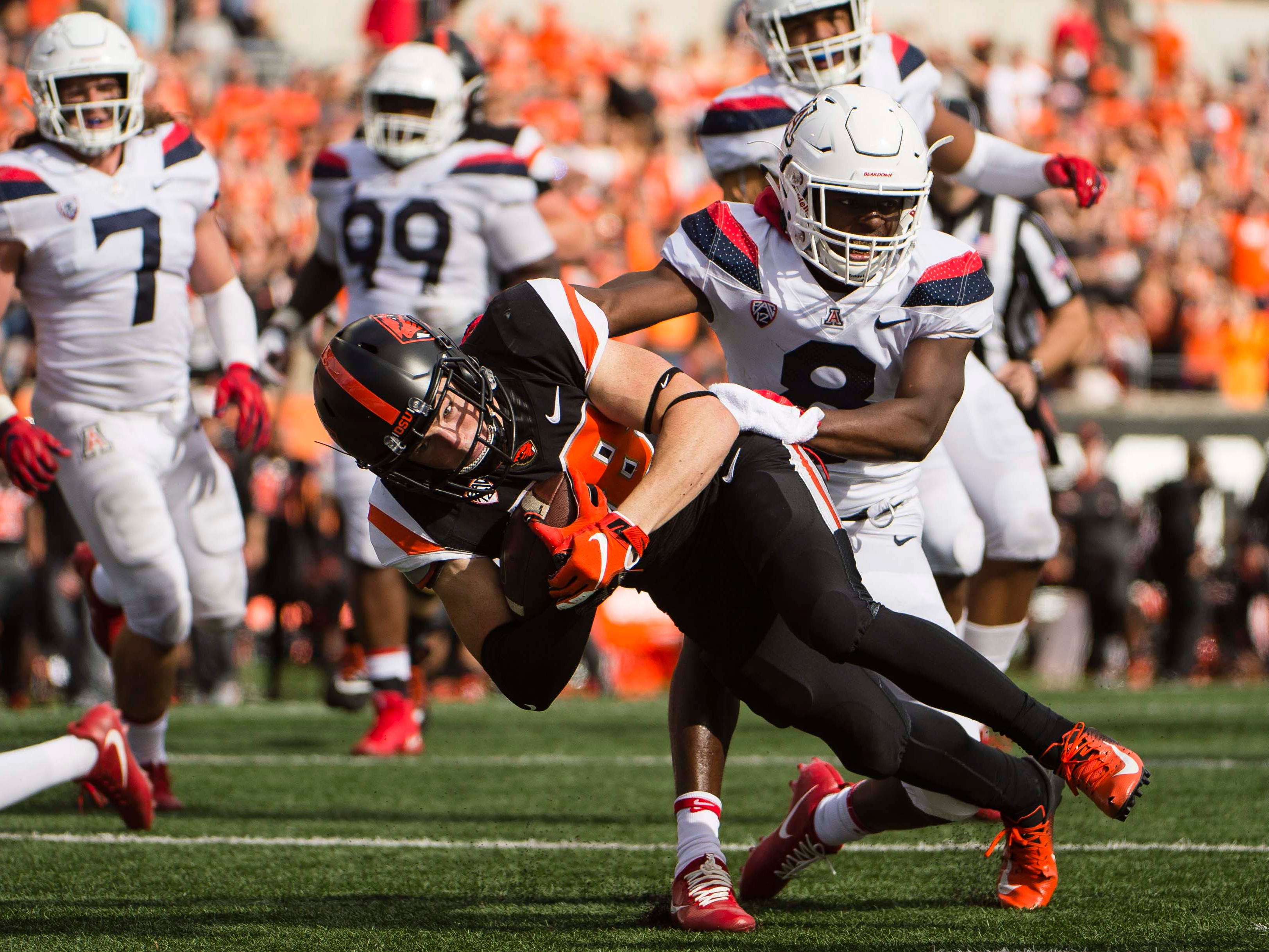 Sep 22, 2018; Corvallis, OR, USA; Oregon State Beavers wide receiver Timmy Hernandez (18) scores a touchdown during the second half against Arizona Wildcats cornerback Tim Hough (8) at Reser Stadium. The Arizona Wildcats won 35-14.