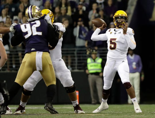 Arizona State quarterback Manny Wilkins (5) looks to pass the ball as Washington defensive lineman Jaylen Johnson (92) is blocked by Arizona State offensive lineman Cohl Cabral during the first half of an NCAA college football game Saturday, Sept. 22, 2018, in Seattle.
